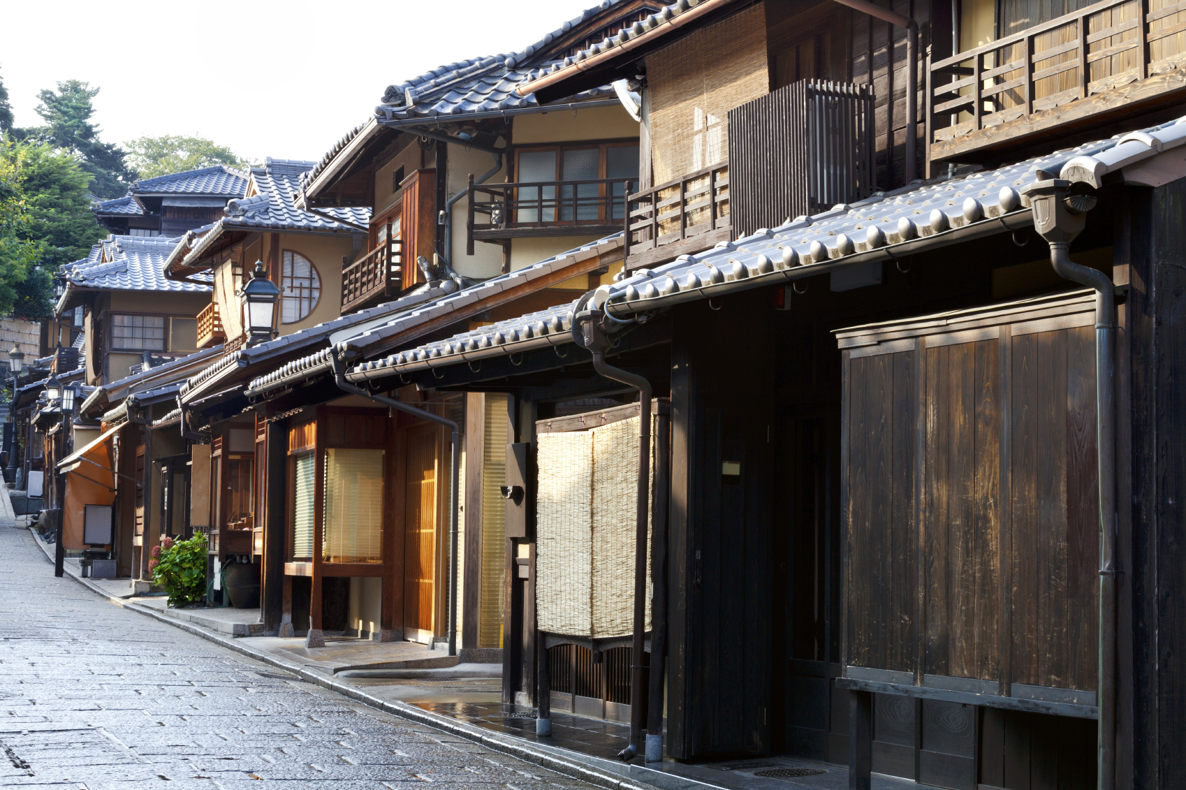 Street of old wooden houses in historic Kyoto Japan